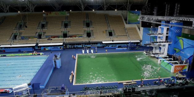 The water of the diving pool at right appears a murky green, in stark contrast to the pool's previous day's color and also that of the clear blue water in the second pool for water polo at the venue as divers train in the Maria Lenk Aquatic Center at the 2016 Summer Olympics in Rio de Janeiro, Brazil, Tuesday, Aug. 9, 2016. (AP Photo/Matt Dunham)
