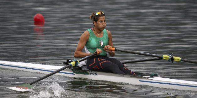 2016 Rio Olympics - Rowing - Repechage - Women's Single Sculls Repechages - Lagoa Stadium - Rio De Janeiro, Brazil - 08/08/2016. Amina Rouba (ALG) of Algeria competes. REUTERS/Carlos Barria  FOR EDITORIAL USE ONLY. NOT FOR SALE FOR MARKETING OR ADVERTISING CAMPAIGNS.