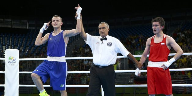 2016 Rio Olympics - Boxing - Preliminary - Men's Light (60kg) Round of 16 Bout 73 - Riocentro - Pavilion 6 - Rio de Janeiro, Brazil - 09/08/2016. Reda Benbaziz (ALG) of Algeria celebrates after winning his bout against Adlan Abdurashidov (RUS) of Russia. REUTERS/Peter Cziborra FOR EDITORIAL USE ONLY. NOT FOR SALE FOR MARKETING OR ADVERTISING CAMPAIGNS.