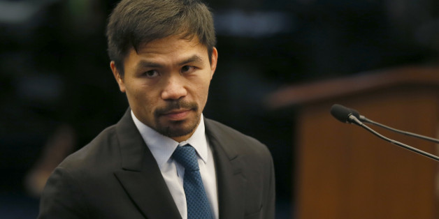 "Filipino boxer and now Senator Manny Pacquiao listens to an interpellation by a fellow senator shortly after delivering his ""privileged speech"" at the session of the Philippine Senate Monday, Aug. 8, 2016, in suburban Pasay city south of Manila, Philippines. Pacquiao urged Congress to pass a law to restore capital punishment in the wake of the ""War on Drugs"" campaign by Philippine President Rodrigo Duterte.(AP Photo/Bullit Marquez)"
