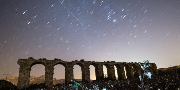 ANTALYA, TURKEY - DECEMBER 14: Perseid meteor streaks across the sky above historical aqueduct at ancient city of Aspendos in Serik district of Antalya, Turkey on December 14, 2015. (Photo by Mustafa Ciftci/Anadolu Agency/Getty Images)