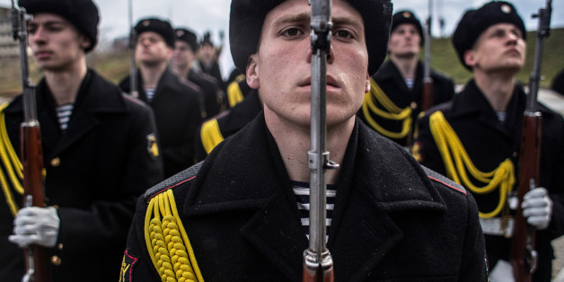 SEVASTOPOL, CRIMEA - MARCH 18:  Soldiers of the honor guard prepare to march as people celebrate the first anniversary of the signing of the decree on the annexation of the Crimea by the Russian Federation, on March 18, 2015 in Sevastopol, Crimea. Crimea, an internationally recognised Ukrainian territory with special status, was annexed by the Russian Federation on March 18, 2014. The annexation, which has been widely condemned, took place in the aftermath of the Ukranian revolution. (Photo by Alexander Aksakov/Getty Images)