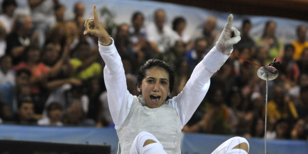 Tunisia's Ines Boubakri celebrates her bronze medal in the women's individual foil event, at the Mediterranean games in Pineto, Italy, Monday, June 29, 2009. (AP Photo/Sandro Perozzi)