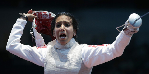 Tunisia's Ines Boubakri celebrates winning against France's Astrid Guyart (not pictured) during their women's Individual Foil round of 16 fencing competition at the ExCel venue at the London 2012 Olympic Games July 28, 2012.  REUTERS/Max Rossi (BRITAIN  - Tags: SPORT OLYMPICS)