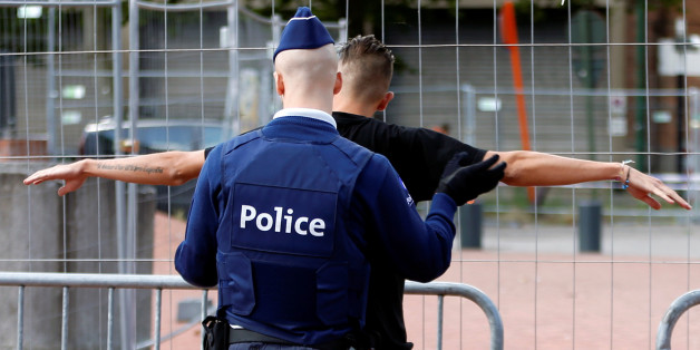 A Belgian police officer searches a visitor outside the main police station where a machete-wielding assailant attacked and injured two female police officers on Saturday in Charleroi, August 9, 2016. REUTERS/Francois Lenoir