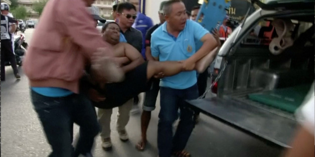 Rescuers and medical officers carry an injured person onto an ambulance truck after a bomb blast in Hua Hin, south of Bangkok, Thailand, in this still image taken from video August 12, 2016. REUTERS/REUTERS TV