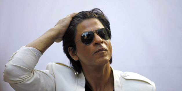 Bollywood superstar Shah Rukh Khan gestures as he speaks to the media outside his home on his birthday in Mumbai, India, Friday, Nov. 2, 2012. (AP Photo/Rafiq Maqbool)