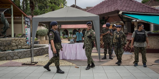PHUKET, THAILAND - AUGUST 12: Thai security forces stand guard at the scene of a blast near Patong beach on Phuket (847 kilometers south of Bangkok) on August 12, 2016. A series of bomb blasts targeted four cities in southern Thailand overnight as the country prepared to celebrate the birthday of its queen, killing at least three people and injuring around 35.   (Photo by Guillaume Payen/Anadolu Agency/Getty Images)