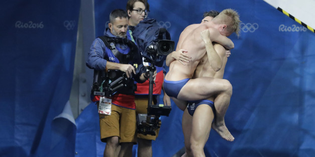 Britain's Jack Laugher and Chris Mears celebrate after winning the men's synchronized 3-meter springboard diving final in the Maria Lenk Aquatic Center at the 2016 Summer Olympics in Rio de Janeiro, Brazil, Wednesday, Aug. 10, 2016. (AP Photo/Wong Maye-E)