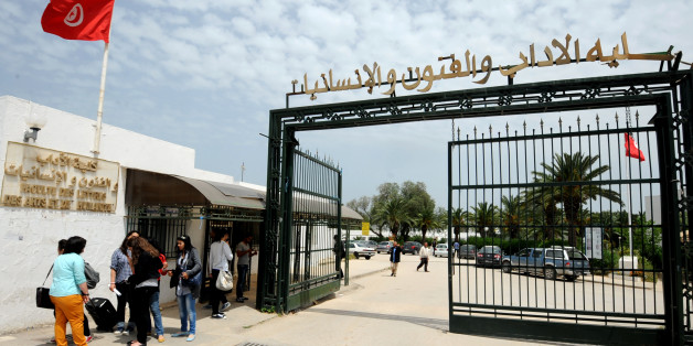 Tunisian students arrive at the Manouba University, outside Tunis, on May 2, 2013. The dean of the Manouba Faculty of Arts, Letters, and Humanities, Habib Kazdaghli  accused of slapping a veiled female student was acquitted in a case that has come to symbolise bristling tensions between Islamists and secularists.  AFP PHOTO / FETHI BELAID        (Photo credit should read FETHI BELAID/AFP/Getty Images)
