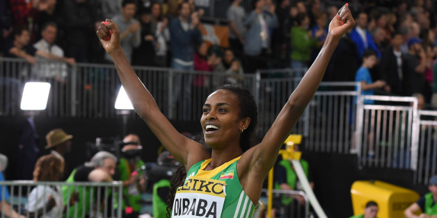Ethiopia's Genzebe Dibaba celebrates winning the 3000 meters final at the IAAF World Indoor athletic championships in Portland, Oregon on March 20, 2016. / AFP / Mark Ralston        (Photo credit should read MARK RALSTON/AFP/Getty Images)