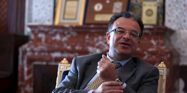 Tunisia's Finance Minister Slim Chaker gestures as he speaks with Reuters journalists in Tunis, Tunisia, October 26, 2015. Tunisia, frustrated by the international community's failure to deliver on pledges of economic support, is asking the Group of Eight major nations for a five-year rescue programme worth $25 billion. Chaker told a Reuters the billions of dollars of aid were needed to ensure Tunisia's political progress was not reversed. Picture taken October 26, 2015. REUTERS/Zoubeir Souissi