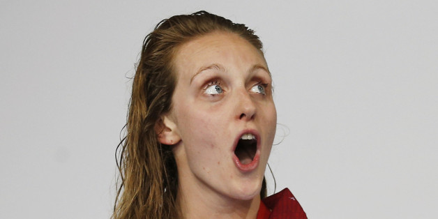 England's Francesca Halsall sings her national anthem after winning the gold medal in the women's 50m Freestyle final at the Commonwealth Games in Glasgow, Scotland, July 26, 2014. REUTERS/Jim Young (BRITAIN - Tags: SPORT SWIMMING)