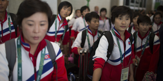 Members of the North Korean olympic team arrive to the Rio de Janeiro International Airport in Rio de Janeiro, Brazil, Thursday, July 28, 2016. (AP Photo/Leo Correa)