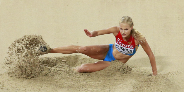 Darya Klishina of Russia competes in the women's long jump final during the 15th IAAF World Championships at the National Stadium in Beijing, China August 28, 2015.         REUTERS/Kim Kyung-Hoon