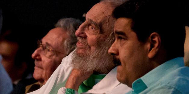Former Cuban leader Fidel Castro (C), Cuba's President Raul Castro (L) and Venezuela's President Nicolas Maduro attend a gala for Fidel Castro's 90th birthday at the Karl Marx theatre in Havana, Cuba, August 13, 2016.