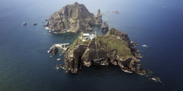 A set of remote islands called Dokdo in Korean and Takeshima in Japanese is seen in this picture taken from a helicopter carrying South Korean President Lee Myung-bak (not pictured), east of Seoul August 10, 2012. Lee visited the islands on Friday, angering neighbour Japan which also lays claims to territory. South Korea controls the islands with a coast guard presence and plans to beef up maritime research.   REUTERS/The Blue House/Handout   (POLITICS)   FOR EDITORIAL USE ONLY. NOT FOR SALE FOR MARKETING OR ADVERTISING CAMPAIGNS. THIS IMAGE HAS BEEN SUPPLIED BY A THIRD PARTY. IT IS DISTRIBUTED, EXACTLY AS RECEIVED BY REUTERS, AS A SERVICE TO CLIENTS