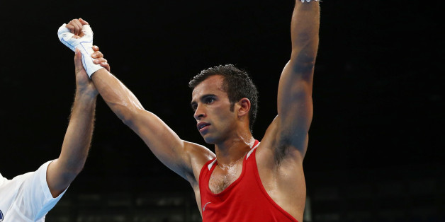 2016 Rio Olympics - Boxing - Preliminary - Men's Fly (52kg) Round of 32 Bout 167 - Riocentro - Pavilion 6 - Rio de Janeiro, Brazil - 13/08/2016. Achraf Kharroubi (MAR) of Morocco reacts after winning his bout. REUTERS/Peter Cziborra FOR EDITORIAL USE ONLY. NOT FOR SALE FOR MARKETING OR ADVERTISING CAMPAIGNS.