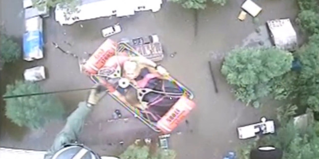 An aircrew from Coast Guard Air Station New Orleans rescues three people from a rooftop due to flooding in Baton Rouge, Louisiana, U.S., A in this still image from video taken on August 13, 2016. Coast Guard Air Station New Orleans/Handout via REUTERS  ATTENTION EDITORS - THIS IMAGE WAS PROVIDED BY A THIRD PARTY. EDITORIAL USE ONLY