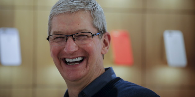 Apple Chief Executive Officer Tim Cook laughs as he speaks during a event for students to learn to write computer code at the Apple store in the Manhattan borough of New York, December 9, 2015.     REUTERS/Carlo Allegri
