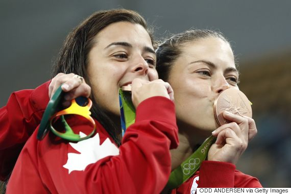 kissing olympic medal canada
