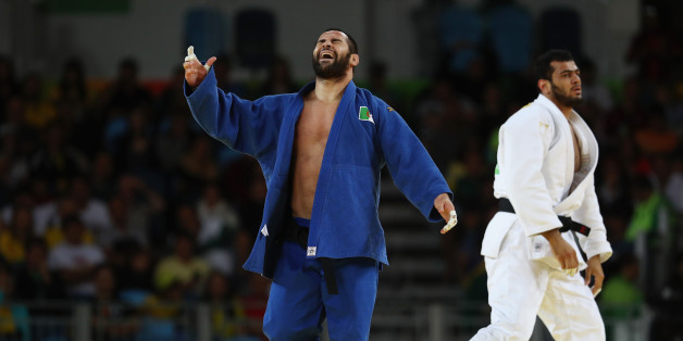 RIO DE JANEIRO, BRAZIL - AUGUST 11: Lyes Bouyacoub of Algeria reacts  during the men's -100kg elimination round judo contest against Elmar Gasimov of Azerbaijan on Day 6 of the 2016 Rio Olympics at Carioca Arena 2 on August 11, 2016 in Rio de Janeiro, Brazil.  (Photo by Julian Finney/Getty Images)