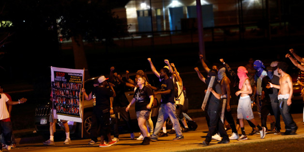 Protestors march toward police lines during disturbances following the police shooting of a man in Milwaukee, Wisconsin, U.S. August 14, 2016. REUTERS/Aaron P. Bernstein