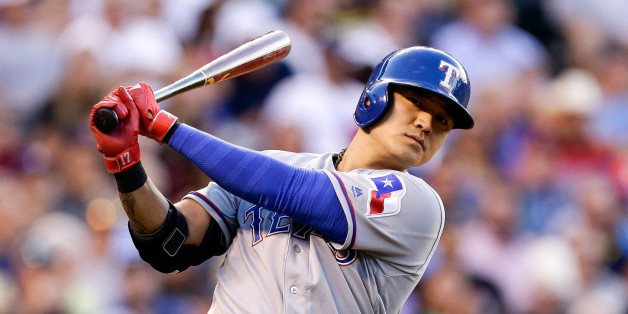 Aug 8, 2016; Denver, CO, USA; Texas Rangers right fielder Shin-Soo Choo (17) in the on-deck circle in the second inning against the Colorado Rockies at Coors Field. Mandatory Credit: Isaiah J. Downing-USA TODAY Sports