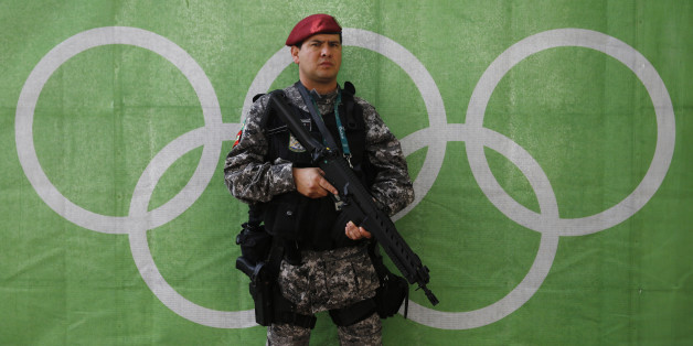 2016 Rio Olympics - Lagoa - 30/07/2016. A police officer stands at the Olympic rowing venue.    REUTERS/Stefan Wermuth  TPX IMAGES OF THE DAY