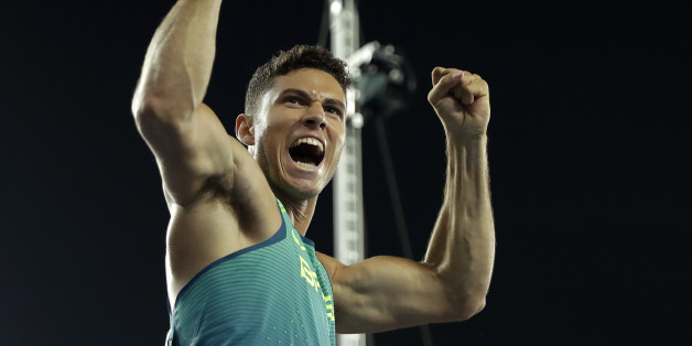 Brazil's Thiago Da Silva celebrates after setting a new Olympic record to win the gold medal in the men's pole vault final during the athletics competitions of the 2016 Summer Olympics at the Olympic stadium in Rio de Janeiro, Brazil, Monday, Aug. 15, 2016. (AP Photo/Matt Slocum)