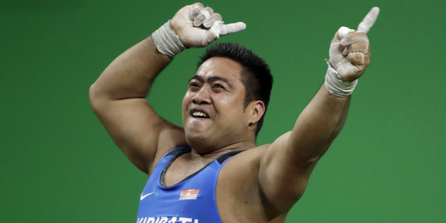 David Katoatau, of Kiribati, dances after a successful lift in the men's 105 kg weightlifting event at the 2016 Summer Olympics in Rio de Janeiro, Brazil, Monday, Aug. 15, 2016. (AP Photo/Mike Groll)