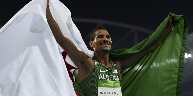 2016 Rio Olympics - Athletics - Final - Men's 800m Final - Olympic Stadium - Rio de Janeiro, Brazil - 15/08/2016. Second placed Taoufik Makhloufi (ALG) of Algeria celebrates.    REUTERS/Dylan Martinez   FOR EDITORIAL USE ONLY. NOT FOR SALE FOR MARKETING OR ADVERTISING CAMPAIGNS.