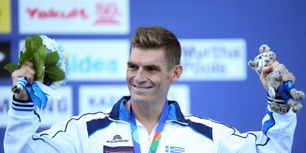Bronze medallist Greece's Spyridon Gianniotis celebrates on the podium after the men's 10 km open water swimming event at the 2015 FINA World Championships in Kazan on July 27, 2015. AFP PHOTO / ROMAN KRUCHININ        (Photo credit should read ROMAN KRUCHININ/AFP/Getty Images)