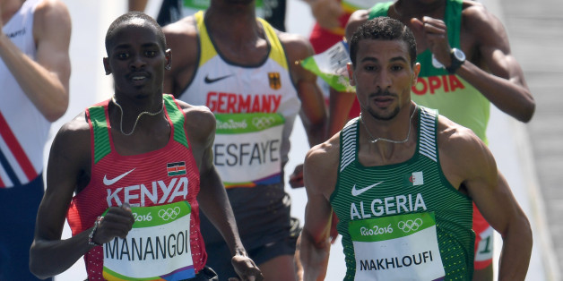 Kenya's Elijah Motonei Manangoi (L) and Algeria's Taoufik Makhloufi compete in the Men's 1500m Round 1 during the athletics event at the Rio 2016 Olympic Games at the Olympic Stadium in Rio de Janeiro on August 16, 2016.   / AFP / PEDRO UGARTE        (Photo credit should read PEDRO UGARTE/AFP/Getty Images)