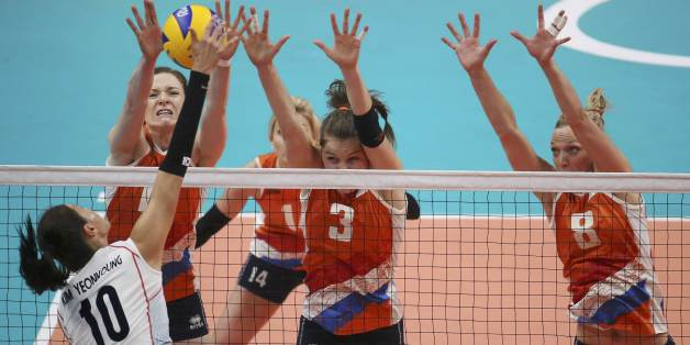 2016 Rio Olympics - Volleyball - Women's Quarterfinals - South Korea v Netherlands - Maracanazinho - Rio de Janeiro, Brazil -16/08/2016. Kim Yeon-Koung (KOR) of South Korea (10) competes against Judith Pietersen (NED) of Netherlands (8), Yvon Belien (NED) of Netherlands (3) and Anne Buijs (NED) of Netherlands. REUTERS/Pilar Olivares FOR EDITORIAL USE ONLY. NOT FOR SALE FOR MARKETING OR ADVERTISING CAMPAIGNS.