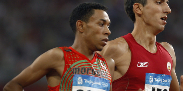 Abdalaati Iguider (L) of Morocco and Arturo Casado of Spain run during their men's 1500m heat in the athletics competition in the National Stadium at the Beijing 2008 Olympic Games August 15, 2008.     REUTERS/Gary Hershorn (CHINA)