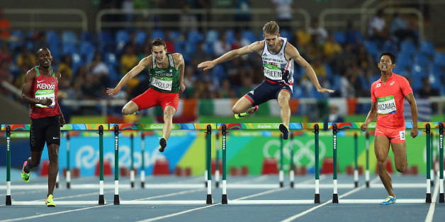 RIO DE JANEIRO, BRAZIL - AUGUST 16:  Boniface Mucheru Tumuti of Kenya, Abdelmalik Lahoulou of Algeria, Jack Green of Great Britain and Keisuke Nozawa of Japan compete during the Men's 400m Hurdles semifinals on Day 11 of the Rio 2016 Olympic Games at the Olympic Stadium on August 16, 2016 in Rio de Janeiro, Brazil.  (Photo by Patrick Smith/Getty Images)