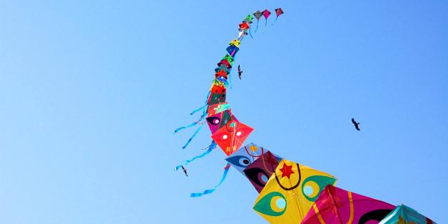 Row of kites in sky at International Kite Festival, Ahmedabad.