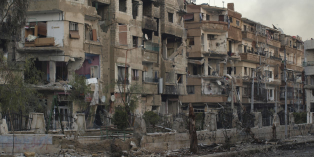 Buildings damaged by what activists said was shelling by forces loyal to President Bashar al-Assad in Daraya January 17, 2013, is seen in this picture provided by Shaam News Network. REUTERS/Kenan Al-Derani/Shaam News Network/Handout (SYRIA - Tags: POLITICS CIVIL UNREST MILITARY CONFLICT) ATTENTION EDITORS - THIS PICTURE WAS PROVIDED BY A THIRD PARTY. REUTERS IS UNABLE TO INDEPENDENTLY VERIFY THE AUTHENTICITY, CONTENT, LOCATION OR DATE OF THIS IMAGE. FOR  EDITORIAL USE ONLY. NOT FOR SALE FOR MAR