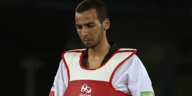 2016 Rio Olympics - Taekwondo - Quarterfinal - Men's - 58kg Quarterfinals - Carioca Arena 3 - Rio de Janeiro, Brazil - 17/08/2016. Omar Hajjami (MAR) of Morocco reacts after losing the match. REUTERS/Issei Kato FOR EDITORIAL USE ONLY. NOT FOR SALE FOR MARKETING OR ADVERTISING CAMPAIGNS.