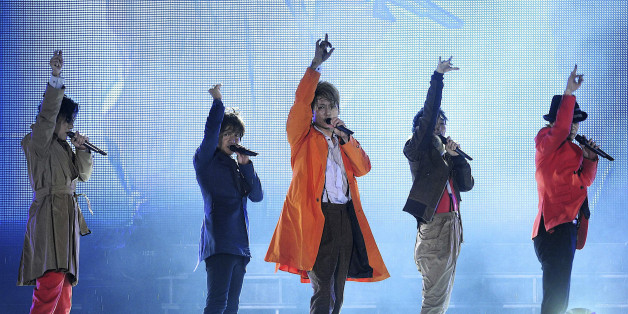 "Members of Japanese pop music group SMAP (from L) Goro Inagaki, Takuya Kimura, Shingo Katori, Tsuyoshi Kusanagi, Masahiro Nakai perform during their concert in Beijing, September 16, 2011. China has warmly welcomed Japanese pop group SMAP ahead of a concert in Beijing on Friday, whose theme is ""Do Your Best Japan, Thank You China, Asia is One"" in gratitude for Chinese help after Japan's March tsunami disaster. Picture taken September 16, 2011. REUTERS/China Daily (CHINA - Tags: SOCIETY ENTERTAIN"