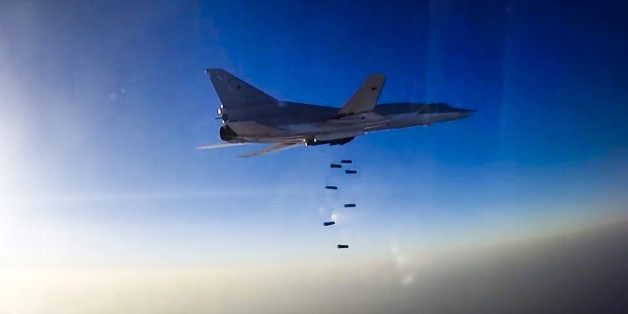 In this frame grab provided by Russian Defence Ministry press service, Russian long range bomber Tu-22M3 flies during an air strike over Aleppo region of Syria on Tuesday, Aug. 16, 2016. Russia's Defense Ministry said on Tuesday Russian warplanes have taken off from a base in Iran to target Islamic State fighters in Syria. (Russian Defence Ministry Press Service photo via AP)
