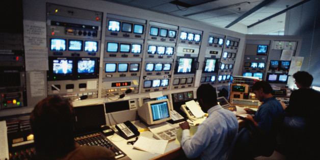 People in control room.