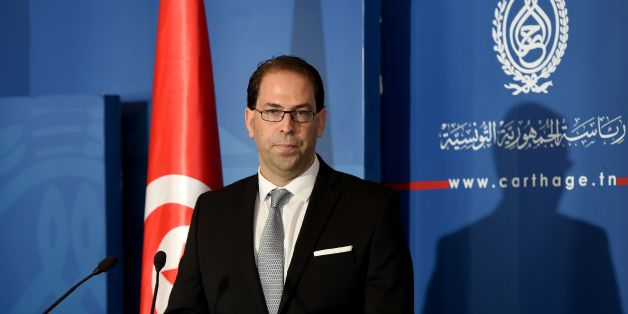 Tunisia's newly appointed prime minister-delegate Youssef Chahed speaks to the press after being appointed by the Tunisian president at Carthage Palace in Carthage, some 15 kilometres on the outskirts of Tunis, on August 3, 2016.