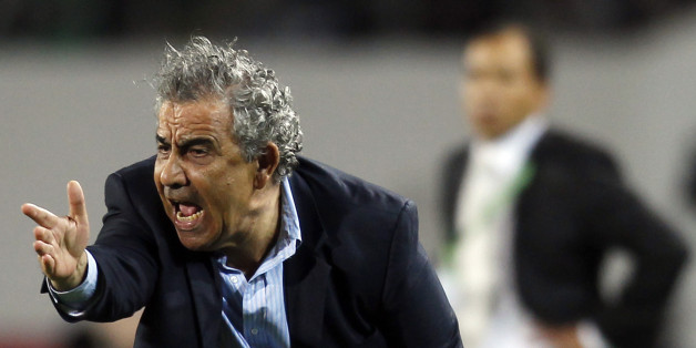 Morocco's Raja Casablanca coach Faouzi Benzarti reacts during their FIFA Club World Cup soccer match against Mexico's Monterrey at Stade Adrar stadium in Agadir December 14, 2013. Hosts Raja Casablanca beat CONCACAF champions Monterrey 2-1 in extra time to reach the Club World Cup semi-finals and send their green and white army of fans into raptures on Saturday. REUTERS/Amr Abdallah Dalsh (MOROCCO - Tags: SPORT SOCCER)