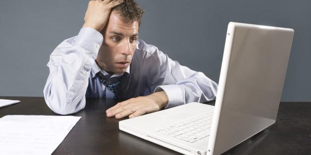 Caucasian business man sweating at desk
