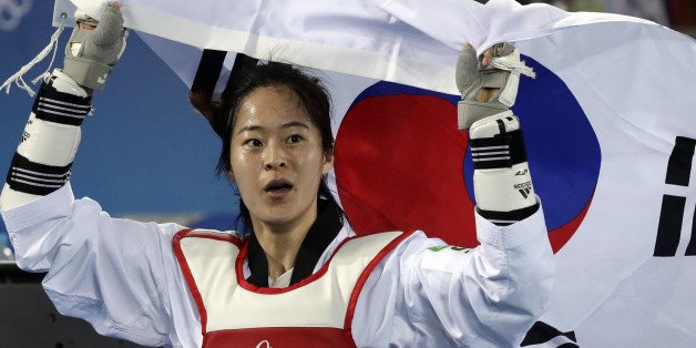 Oh Hyeri of South Korea celebrates after winning a women's Taekwondo 67-kg final at the 2016 Summer Olympics in Rio de Janeiro, Brazil, Friday, Aug. 19, 2016. (AP Photo/Andrew Medichini)
