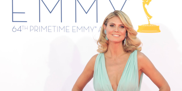 "Heidi Klum, host of the reality competition series ""Project Runway"" arrives at the 64th Primetime Emmy Awards in Los Angeles September 23, 2012.  REUTERS/Mario Anzuoni (UNITED STATES  Tags: ENTERTAINMENT) (EMMYS-ARRIVALS)"