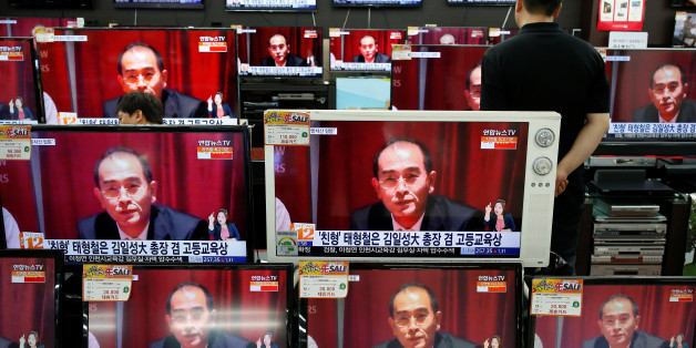 A sales assistant watches TV sets broadcasting a news report on Thae Yong Ho, North Korea's deputy ambassador in London, who has defected with his family to South Korea, in Seoul, South Korea, August 18, 2016.  REUTERS/Kim Hong-Ji     TPX IMAGES OF THE DAY