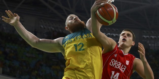 2016 Rio Olympics - Basketball - Semifinal - Men's Semifinal Australia v Serbia - Carioca Arena 1 - Rio de Janeiro, Brazil - 19/8/2016. Nikola Jokic (SRB) of Serbia and Aron Baynes (AUS) of Australia in action. REUTERS/Jim Young  FOR EDITORIAL USE ONLY. NOT FOR SALE FOR MARKETING OR ADVERTISING CAMPAIGNS.
